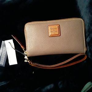 Brand new dooney and bourke wrist wallet